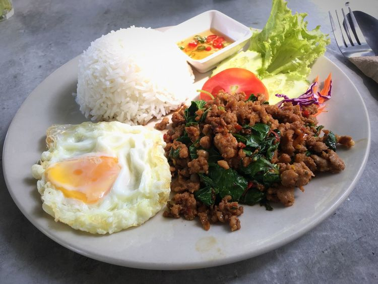 Rice topped with stir fired pork and basil leaf. Egg Plate Food Ready-to-eat Food And Drink Healthy Eating Fried Egg Indoors  No People Freshness Serving Size Breakfast Table Egg Yolk Close-up Fried Rice Day Pork Rice Basil