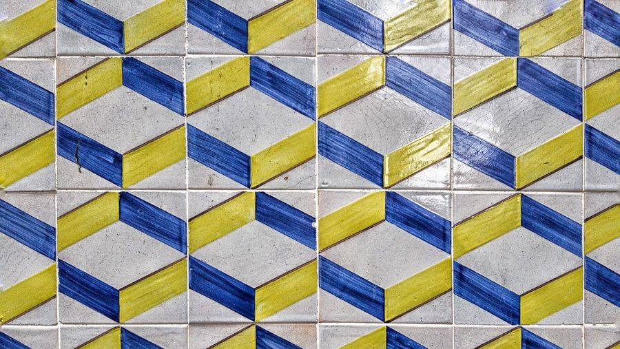 Close up view of a blue-yellow white facade in Lisbon Portugal. Architecture Façade Architectural Detail Protection Saltwater Façade Pattern Backgrounds Multi Colored Full Frame Textured  Seamless Pattern Pattern Tile Close-up Tiled Wall Geometric Shape Repetition Square Shape