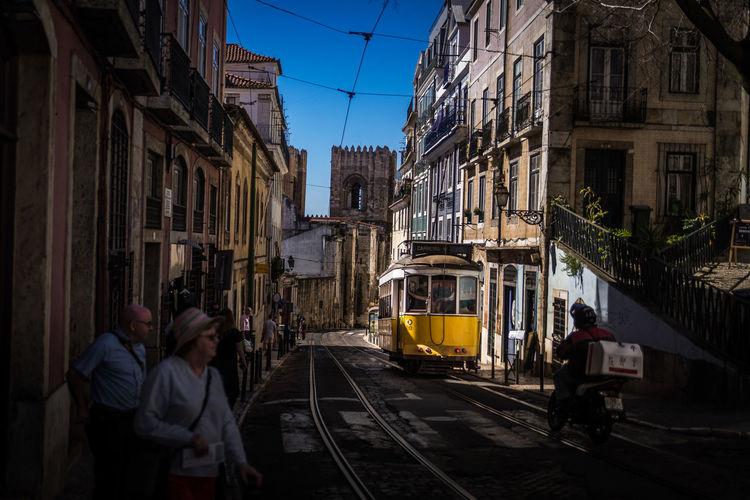 Adult Architecture Cable Car City City Life Cityscape Daily Life Outdoors People Public Transportation Street Transportation Travel Travel Destinations