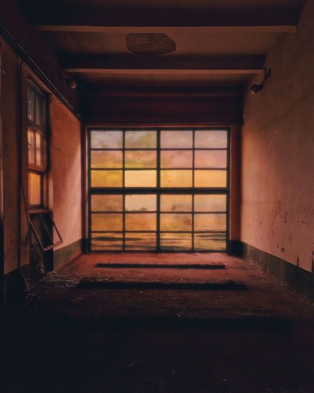 Abandoned industrial interior with glass wall