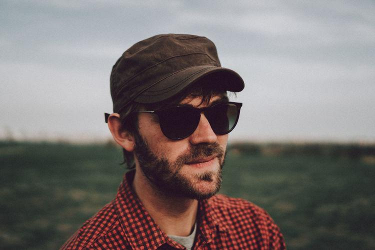 Exterior Fashion Man Beard Lifestyles Outdoors Park Portrait Portrait Of A Man  Summer Sunglasses Young Adult