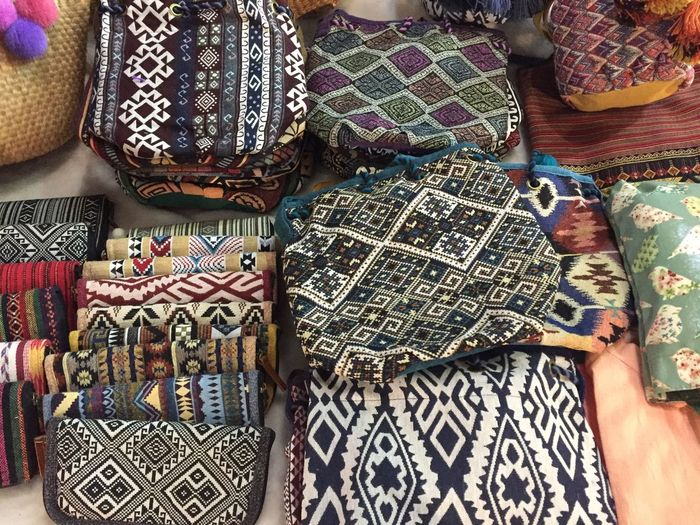 High Angle View Of Multi Colored Purses For Sale In Market