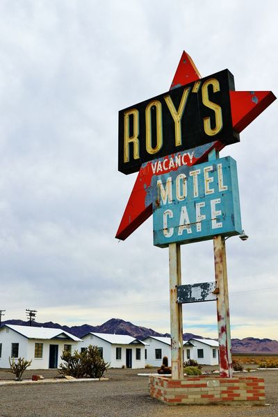Roy's cafe and motel,Historic road Route 66 America Cafe California Canon EOS 7D Mark II EyeEm Gallery Historic Route 66 Low Angle Motel No Vacancy On The Road Red Road Sign Roy's Motel And Cafe Stockphoto Traveling Trip United States USA USAtrip Vacancy