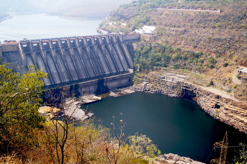 High angle view of dam by river against sky