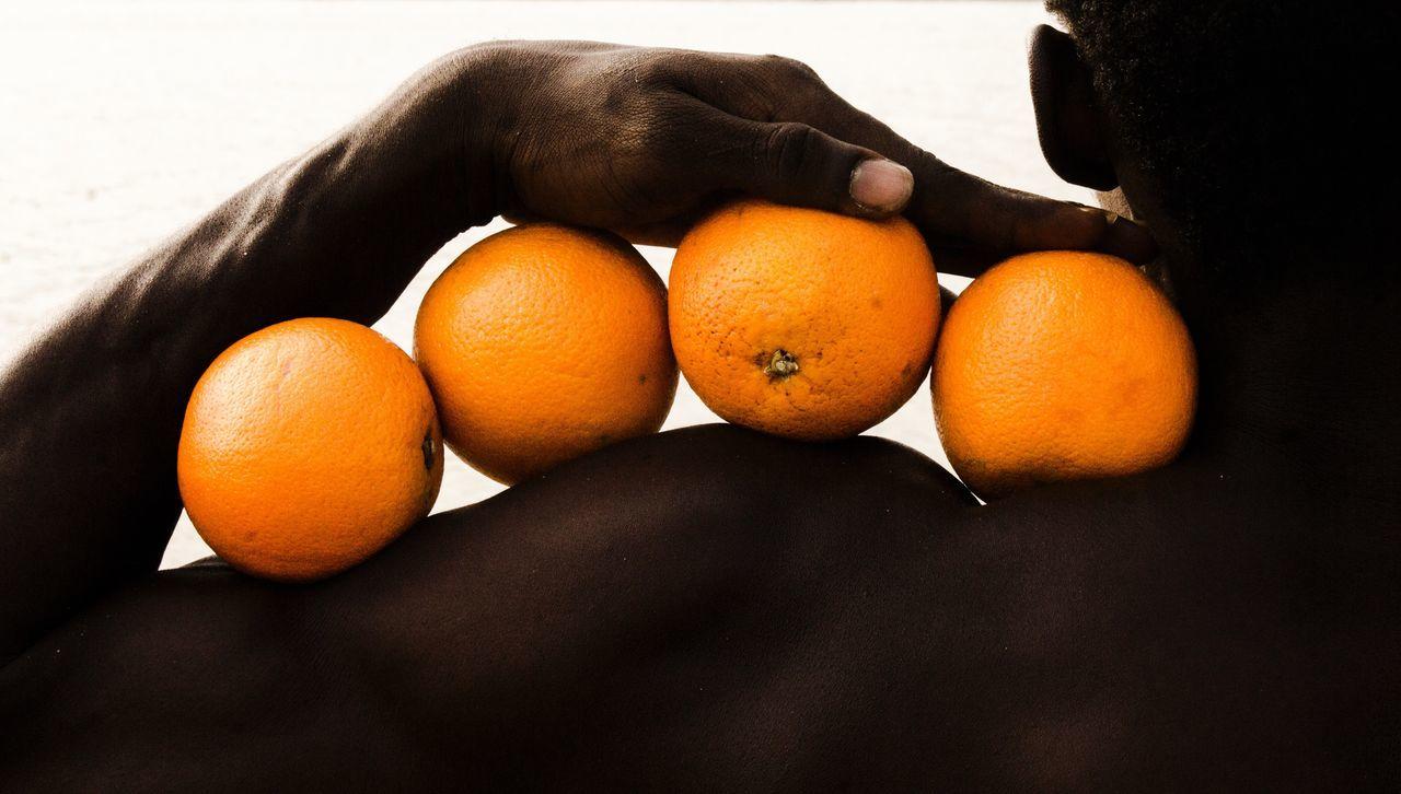 Close-up of oranges on shoulder