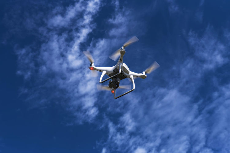 Drone in flight with blue sky nd light clouds Cloud - Sky Day Drone  Flying Low Angle View No People Outdoors Sky Technology