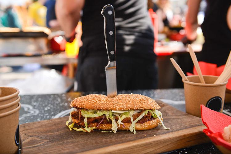 Close-up of hamburger on table