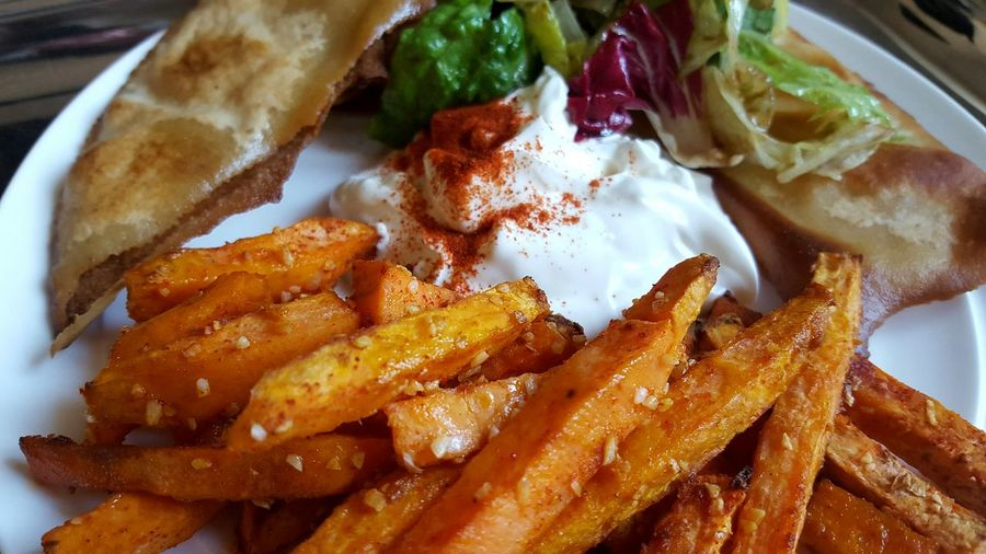 Close-Up Of French Fries With Yogurt Served In Plate