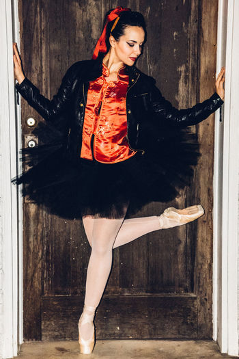 Portrait of ballet dancer in doorway