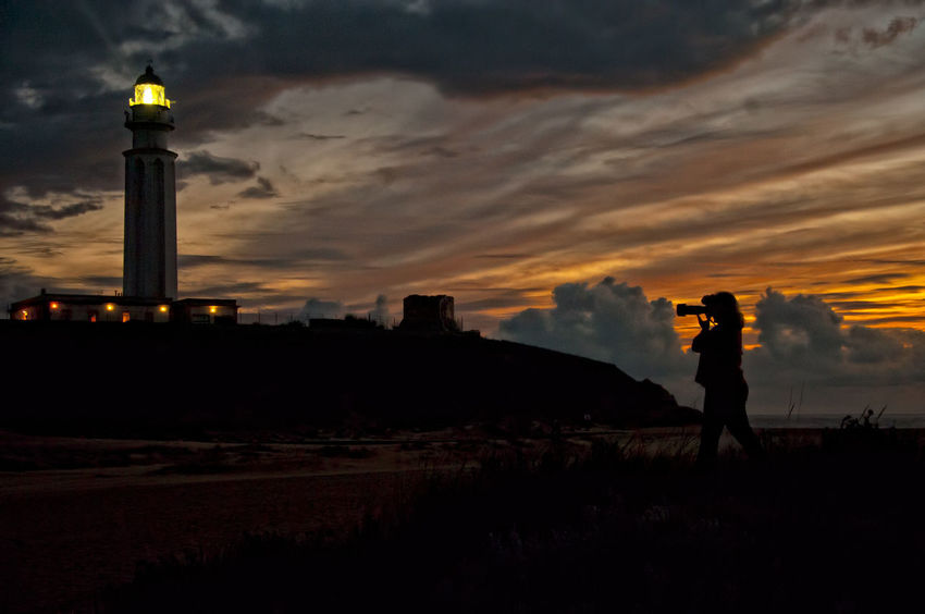 Lighthouse Lighthouse Beach Lighthouse Tower Lighthouse _Collection Lighthouses Architecture Beauty In Nature Building Exterior Built Structure Cloud - Sky Leisure Activity Lighthouse At Dawn Lighthouse At Night Lighthouse At Sundown Lighthouse At Sunset Lighthouse Photography Lighthouse_captures Lighthouse_lovers Lighthousephotography Nature Real People Silhouette Sky Sunset Travel Destinations
