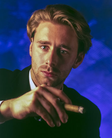 just a man with cigar , NO PHOTOSHOP, negative 6x7 provia Advertising Blue Cigar Face Focus On Foreground Human Intresting Looking At Camera NO PHOTOSHOP, Negative 6x7 Portrait Serious Studio Shot Warm Lights Young Adult Young Men