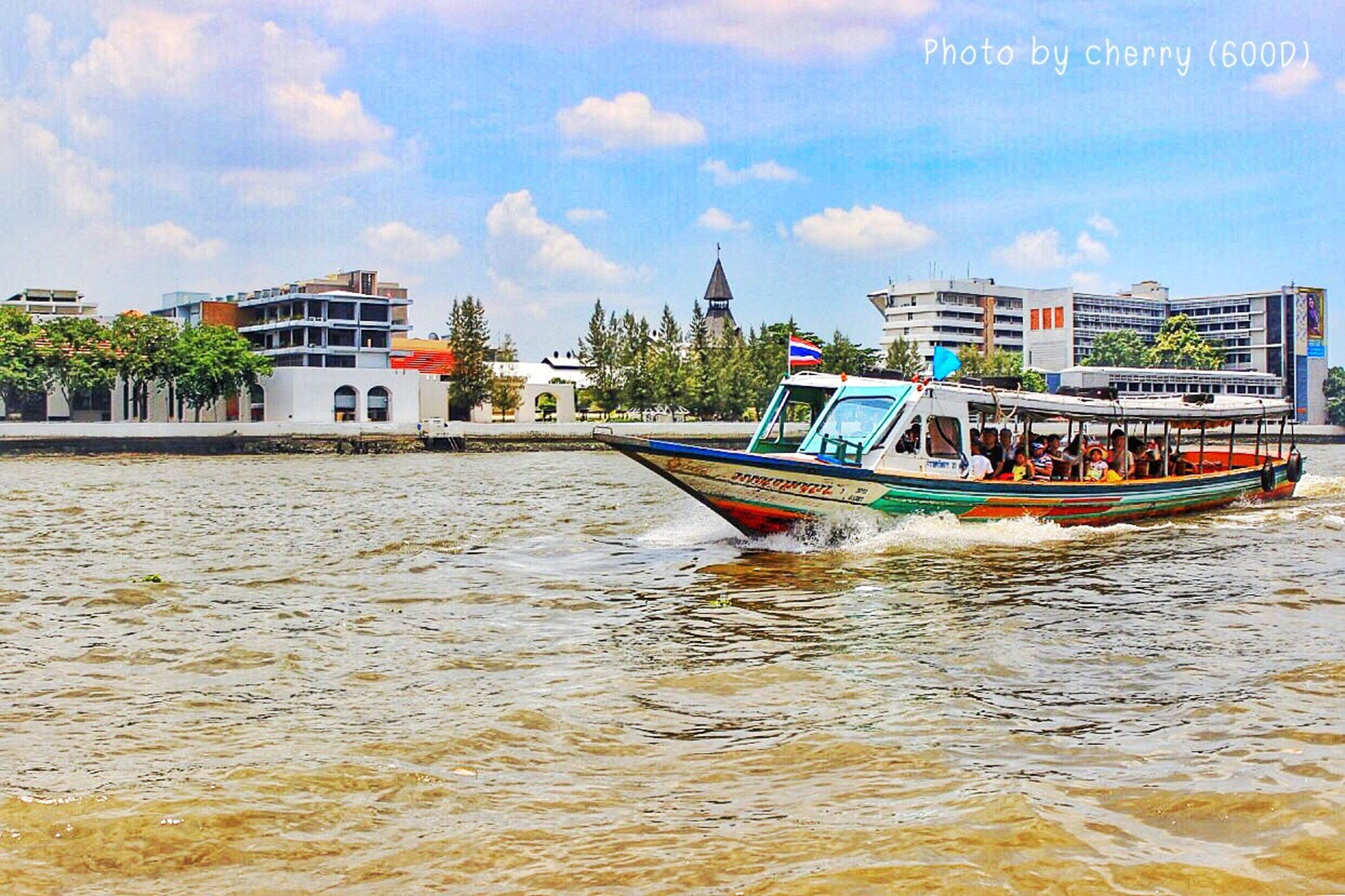 water, building exterior, architecture, built structure, sky, waterfront, nautical vessel, sea, beach, boat, transportation, house, incidental people, mode of transport, cloud - sky, moored, cloud, shore, day, tree