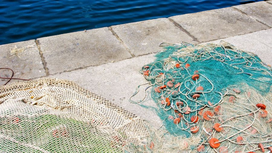 High angle view of fishing net on swimming pool