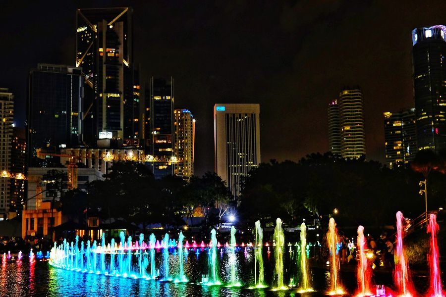 Be. Ready. Night Water Illuminated Skyscraper Building Exterior No People Architecture Urban Skyline Cityscape Outdoors Tree Sky City