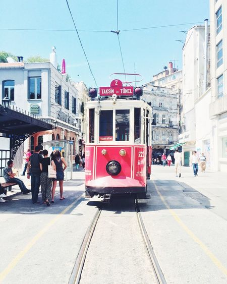 Cable Car Moving On Tramway Amidst Buildings On Sunny Day