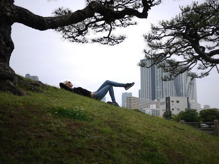 Full length of woman on grass against sky