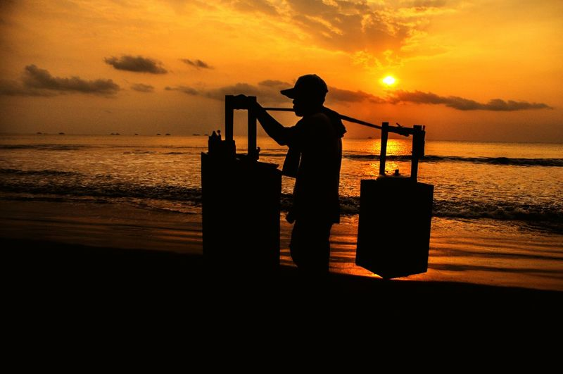 People Silhouette Silhouette Sunset Standing Water Business Finance And Industry Sea One Person Occupation People Outdoors Sky Beach Adult Only Men Working Nature Industry Bakso Work Working Hard Seller Baksoseller