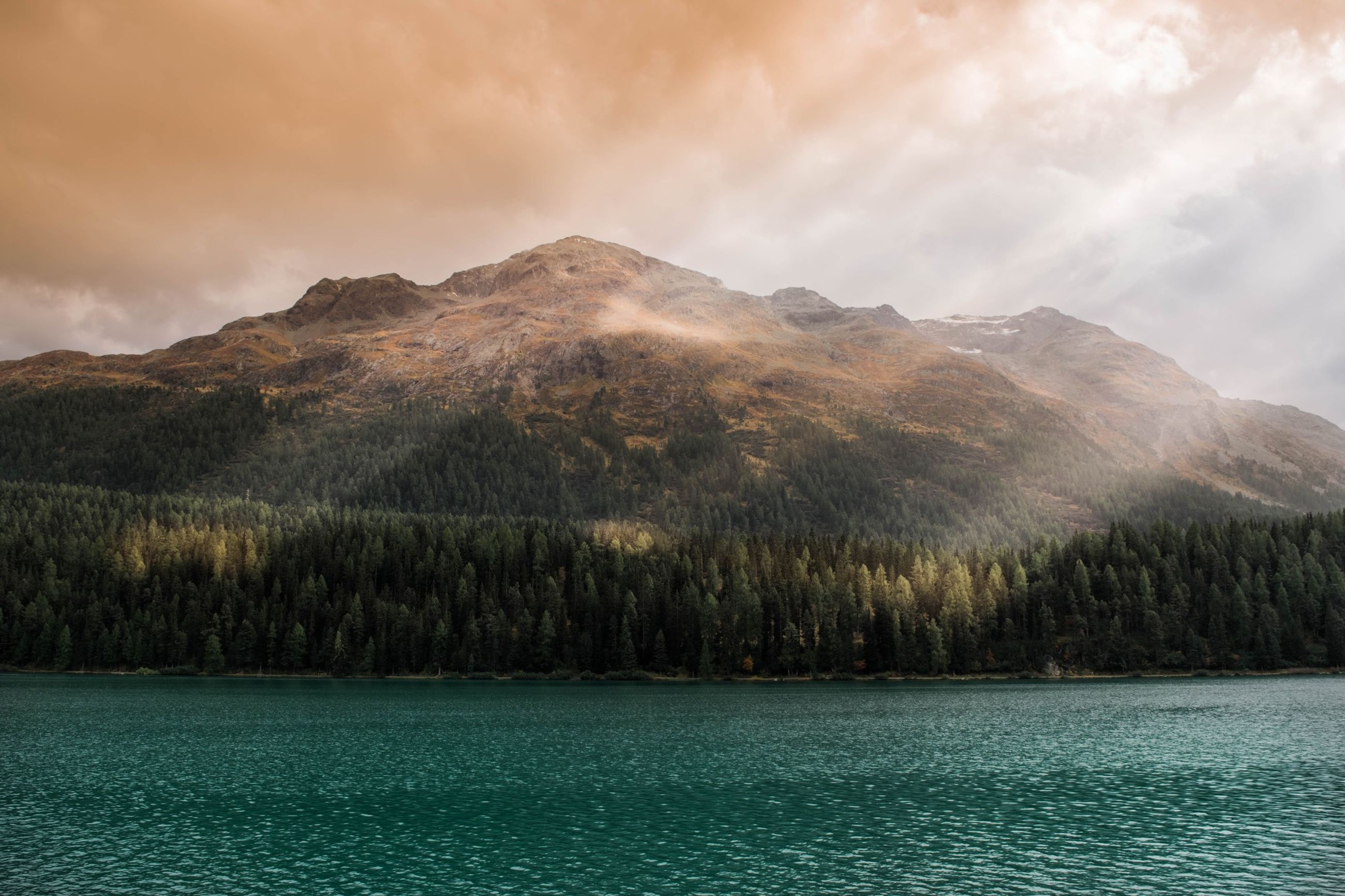 mountain, tranquil scene, sky, tranquility, water, scenics, cloud - sky, beauty in nature, mountain range, lake, waterfront, cloudy, nature, cloud, landscape, river, non-urban scene, idyllic, weather, countryside