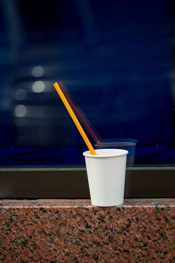Yellow Flower Blue And Yellow Blue Background Building Exterior Close-up Day Drink Drinking Straw Food And Drink Freshness Indoors  No People Outdoors Refreshment Table White Glass Paint The Town Yellow Food Stories