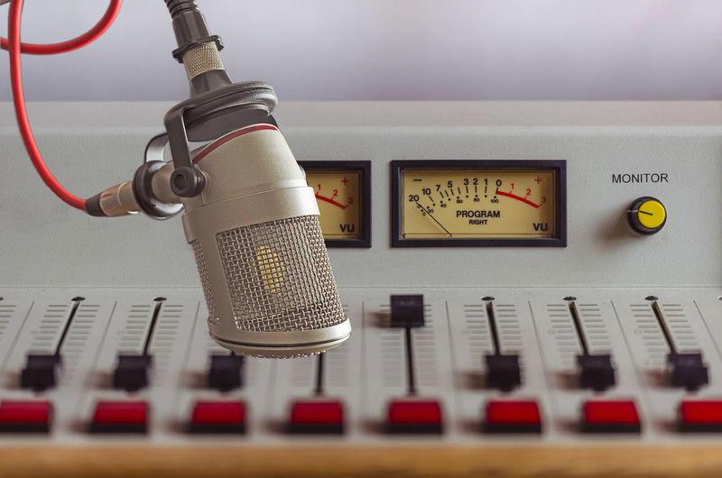 Close-up of microphone over sound recording equipment