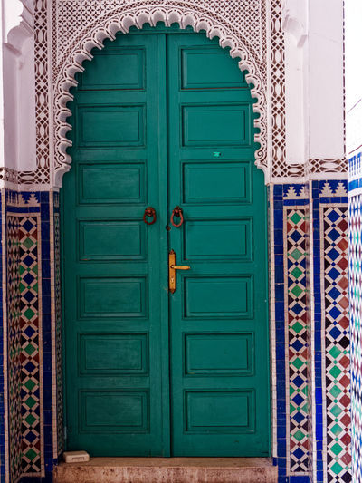 Entrance Door Green Color Closed Architecture Protection No People Built Structure House Building Exterior Security Multi Colored Safety Building Day Pattern Wood - Material Outdoors Front Door Design Turquoise Colored