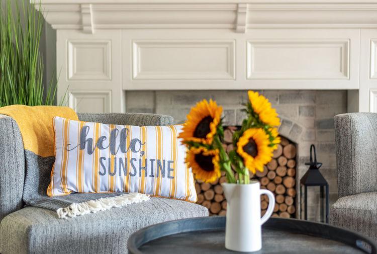 Flowers in vase against house