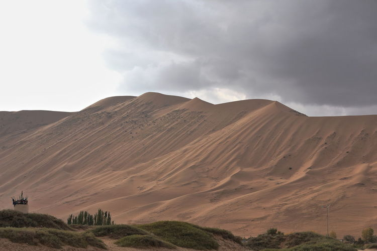 1099 undulating sands-megadune overlooking sumu jaran lake w.shore. badain jaran desert-china.
