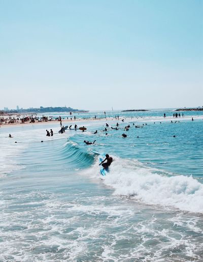 Sea Beach Water Copy Space Real People Nature Beauty In Nature Large Group Of People Leisure Activity Scenics Vacations Day Horizon Over Water Surfing Lifestyles Outdoors Wave Clear Sky Extreme Sports Sport