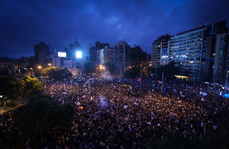 High Angle View Of Soccer Fans Celebrating On Street At Night