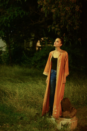 Greek statue played by a Romanian woman Night Lights Night Photography Orange Statue Brunette Contemplation Grass Looking Up One Person Romanian Girl Staged Photography Standing Tree Young Woman HUAWEI Photo Award: After Dark Tranquil Scene Beauty In Nature Capture Tomorrow