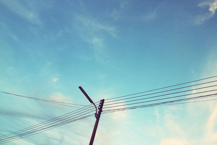 Low Angle View Cable Sky Cloud - Sky Connection Power Line  Power Supply Day Fuel And Power Generation Electricity  Outdoors No People Blue Technology Electricity Pylon Nature Telephone Line Vapor Trail