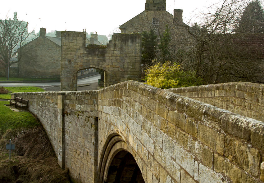 Over the bridge Entrance Gate Ancient Ancient Bridge Ancient Civilization Arch Architecture Building Exterior Built Structure Castle Day History No People Northumberland Old Ruin Outdoors Sky Travel Destinations Tree Turret Warkworth