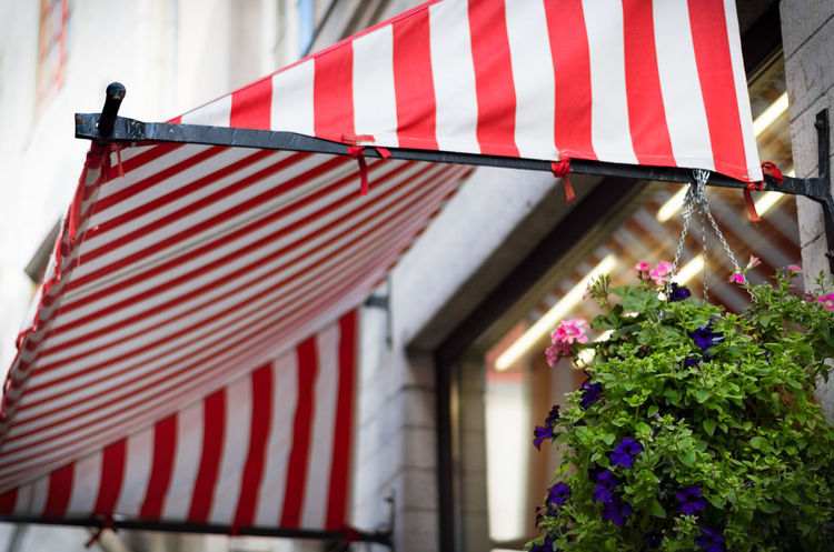 It was such an enjoyable place under this Red & White Awning of a cosy cafe. Architecture Awning Cafe Cafe Awning Cosy Place Day Low Angle View Multi Colored Old Town Outdoors Red Red White Red White Awning Striped Sun Shade Vanalinn