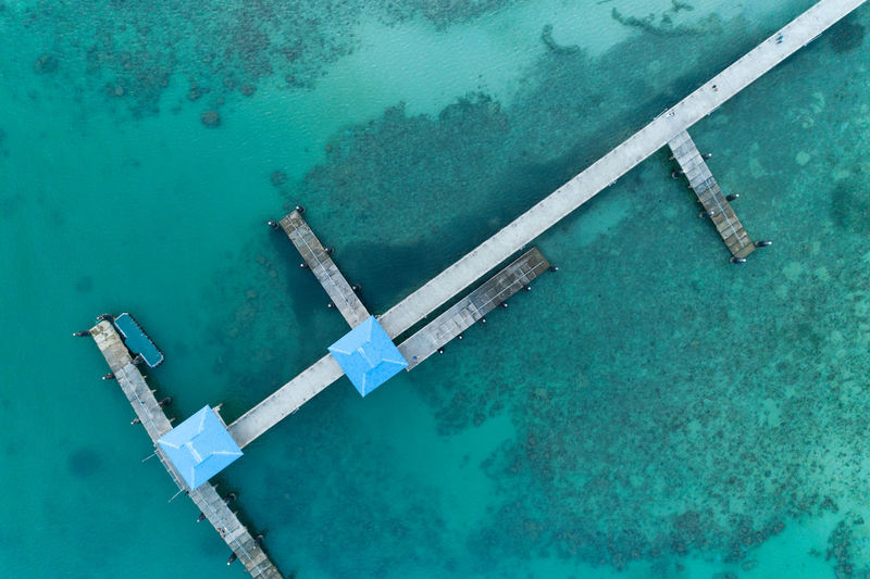 Directly above shot of built structures on pier in sea