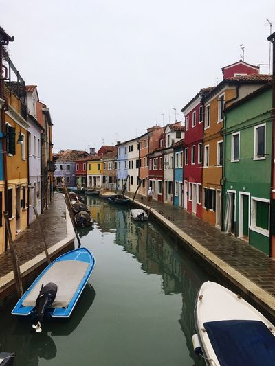 Burano in winter EyeEmNewHere Painted Houses Cloudy Day Winter Moody Sky Italy Burano Building Exterior Built Structure Architecture Water Building Residential District Sky Canal Reflection No People Town House Row House