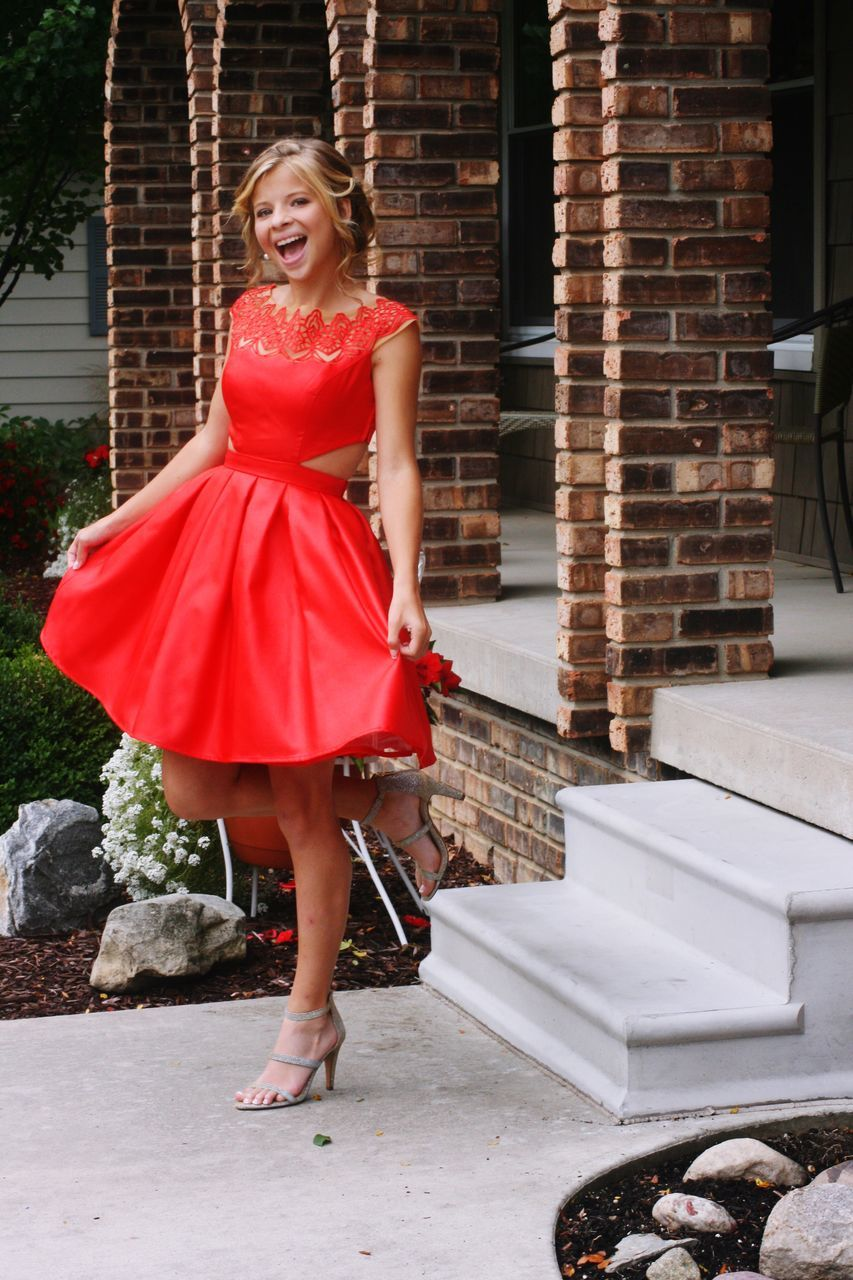 full length, looking at camera, portrait, smiling, beautiful woman, one person, young adult, adults only, only women, one woman only, adult, beautiful people, high heels, red, beauty, one young woman only, elegance, happiness, cheerful, standing, young women, outdoors, people, women, blond hair, fashion model, day, evening gown