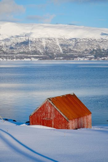 Tromso Architecture Norway Red Water Cold Temperature Snow Winter No People Mountain Nature Beauty In Nature Scenics - Nature Day Sky Architecture Cloud - Sky Sea Snowcapped Mountain Land Outdoors Built Structure