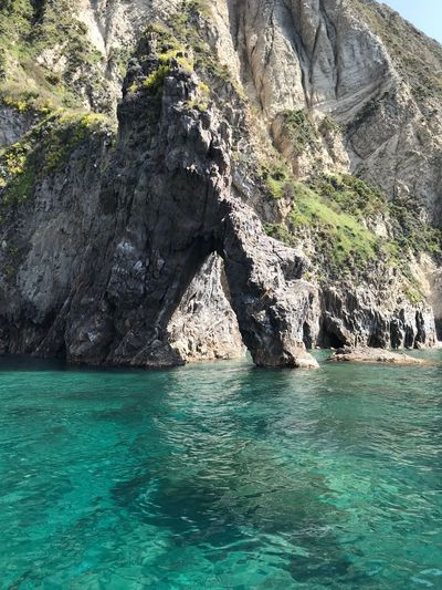 Natural arches on transparent water Italy Palmarola Water Rock Nature Waterfront Day Sea Beauty In Nature Turquoise Colored Solid Rock - Object Sunlight Tranquility No People Scenics - Nature Tranquil Scene Outdoors Land Motion Idyllic Rippled