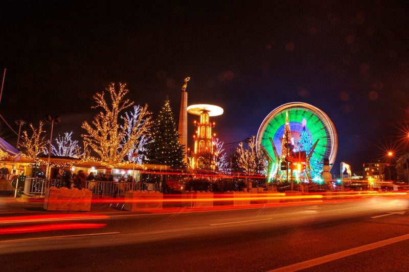 Christmas Decorations Christmastime Luxembourg Illuminated Night Motion Long Exposure Architecture City Light Trail No People Nature Amusement Park Ride Road Transportation Street Sky Blurred Motion Amusement Park Building Exterior Arts Culture And Entertainment Speed Built Structure