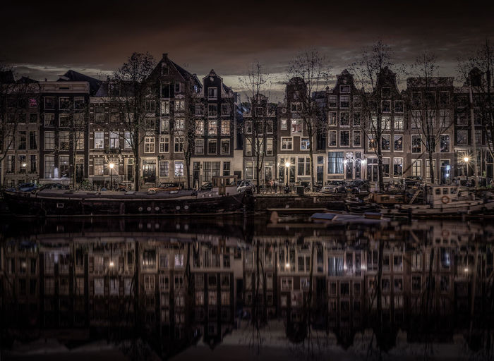 Amsterdam Architecture Building Exterior Built Structure Canal City Cityscape House Illuminated Kromme Waal Nautical Vessel Night No People Outdoors Reflection Sky Travel Destinations Water Waterfront