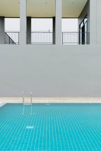 View of swimming pool against building