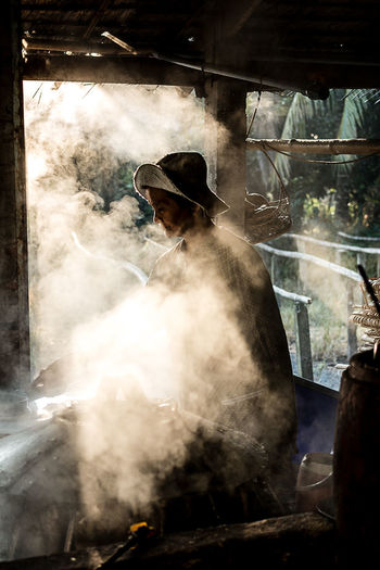 The noodle factory in Mekong delta, Can Tho | Vietnam. ASIA Can Tho Day Factory Food Headwear Heat - Temperature Indoors  Mekong Delta Mekong River Noodle One Person People Portrait Preparation  Real People Smoke Smoke - Physical Structure The Photojournalist - 2017 EyeEm Awards Vietnam Woman Work Working