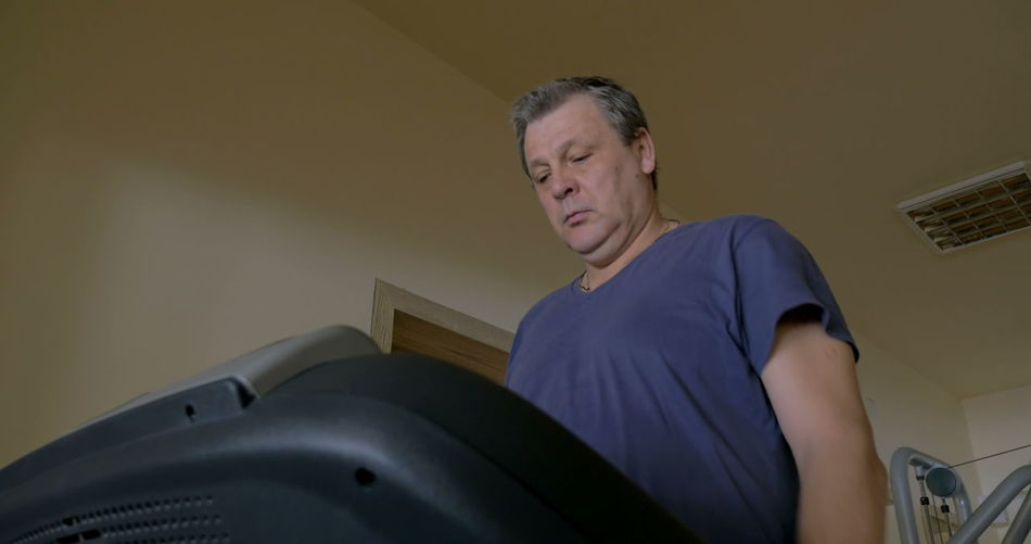 Low angle view of man sitting at home