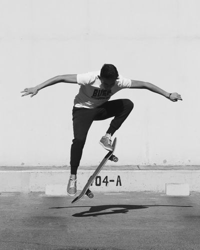 Full length of young man jumping