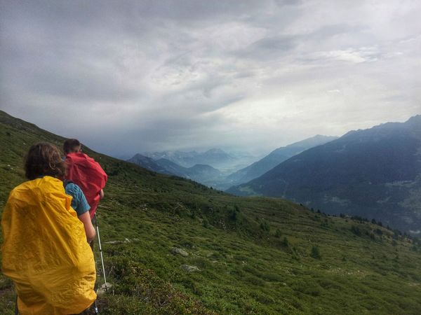 rear view of people on mountain against sky (alps) Alm Alpen Adventure Alps Beauty In Nature Cloud - Sky Day Friendship Hiking Landscape Leisure Activity Lifestyles Men Mountain Nature Outdoors People Real People Rear View Scenics Sky Togetherness Two People Vacations Women