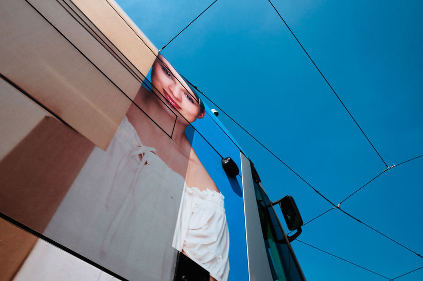 Billboard Blue Cable Low Angle View Sky Streetphotography Tram Urban Phenomenology