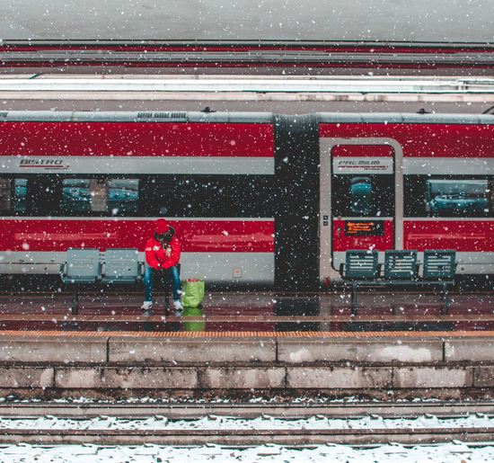 Architecture Building Exterior Built Structure City Clothing Cold Temperature Day Mode Of Transportation Nature Outdoors People Public Transportation Real People Red Snow Snowing Transportation Warm Clothing Winter