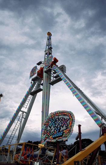 EyeEm Selects Amusement Park Amusement Park Ride Cloud - Sky Sky Arts Culture And Entertainment Low Angle View Architecture Built Structure Fun Enjoyment Rollercoaster Outdoors Incidental People Leisure Activity Carnival Metal
