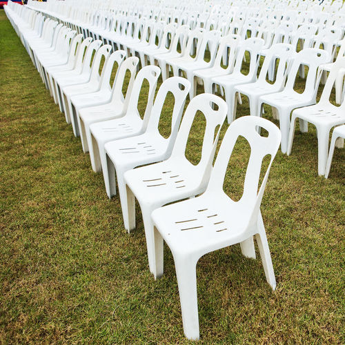 Empty chairs on field