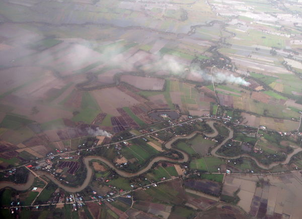 Burning Line Of Smoke Practice Smoke Aerial View Agriculture Canal Curves And Lines Curvy Canal Environment Farm Field From An Airplane Window Fume High Angle View Landscape Open Burning Rainy Season River Rural Scene Season  Trash And Burn